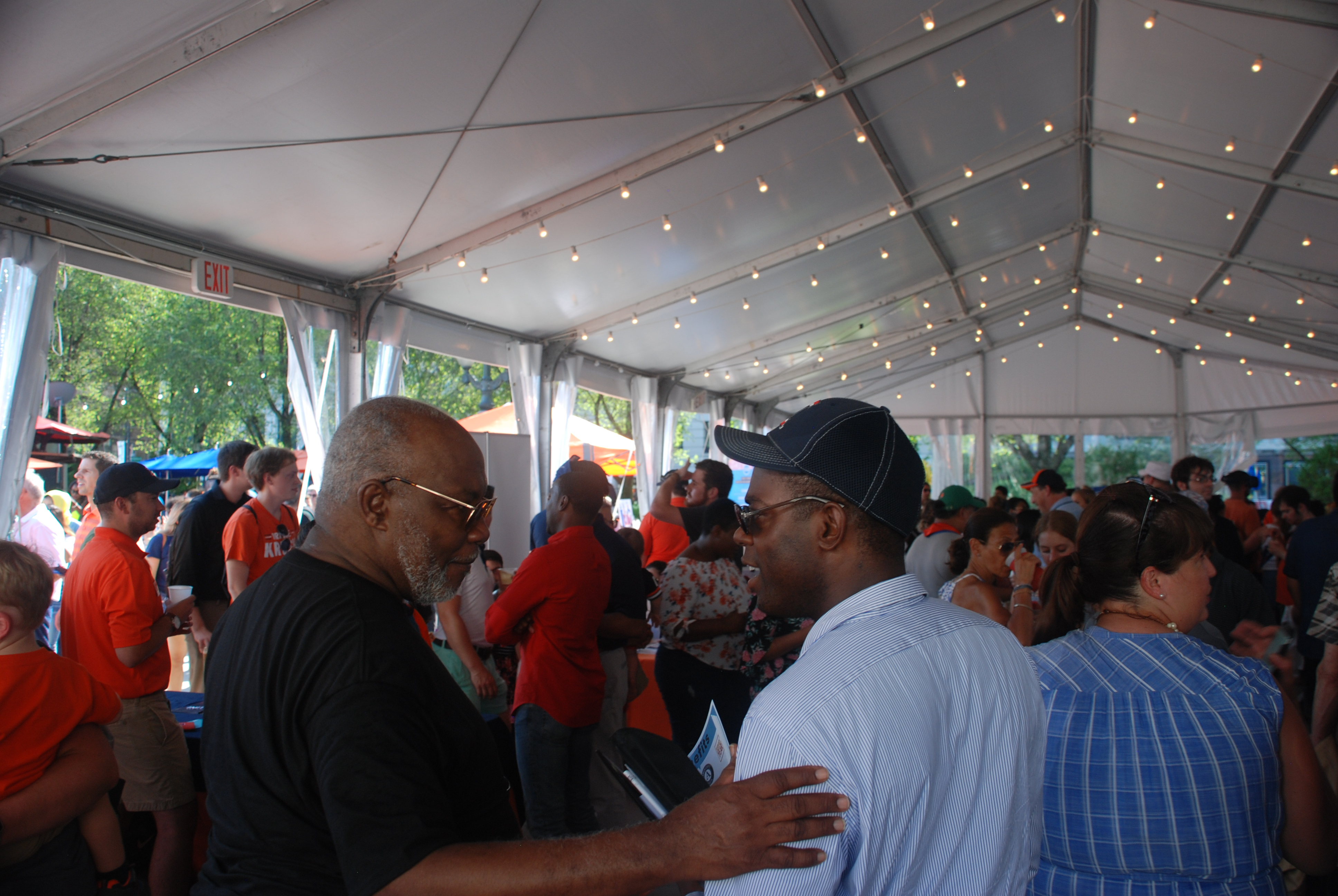 Illini Fest crowd with Dr. Bailey speaking with a visiting colleague in the foreground.